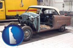 delaware map icon and a vintage automobile in an auto body shop