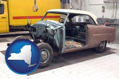 new-york map icon and a vintage automobile in an auto body shop