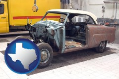 a vintage automobile in an auto body shop - with TX icon