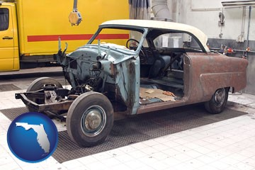 a vintage automobile in an auto body shop - with Florida icon