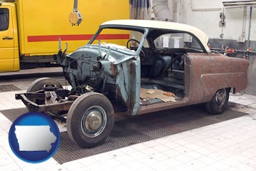a vintage automobile in an auto body shop - with Iowa icon