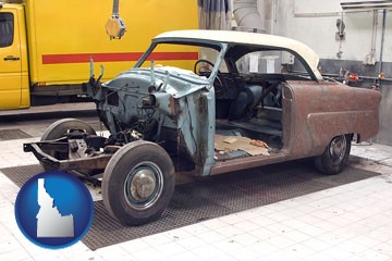 a vintage automobile in an auto body shop - with Idaho icon