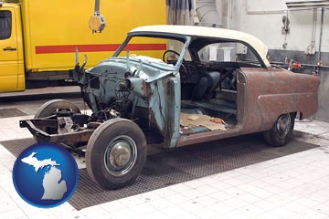 a vintage automobile in an auto body shop - with Michigan icon