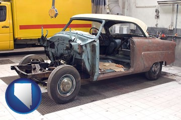a vintage automobile in an auto body shop - with Nevada icon