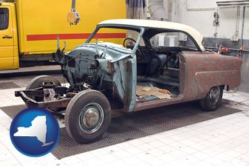 a vintage automobile in an auto body shop - with New York icon