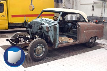 a vintage automobile in an auto body shop - with Ohio icon
