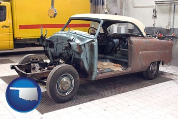 a vintage automobile in an auto body shop - with Oklahoma icon