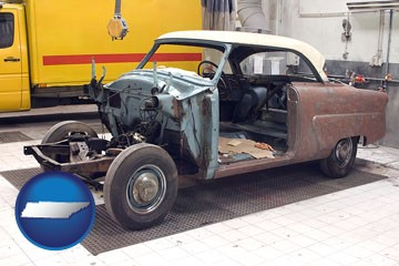 a vintage automobile in an auto body shop - with Tennessee icon