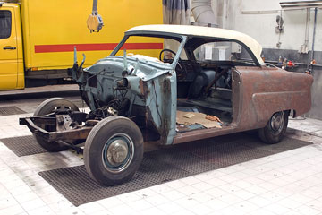 a vintage automobile in an auto body shop